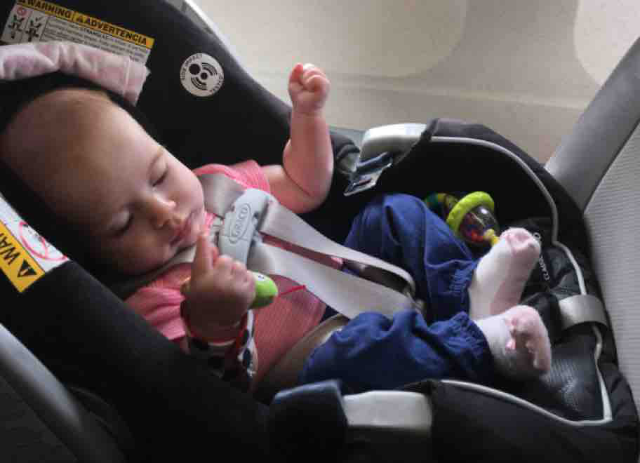 baby sleeping on the plane